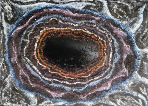 irregular concentric shapes with a central black hole like figure