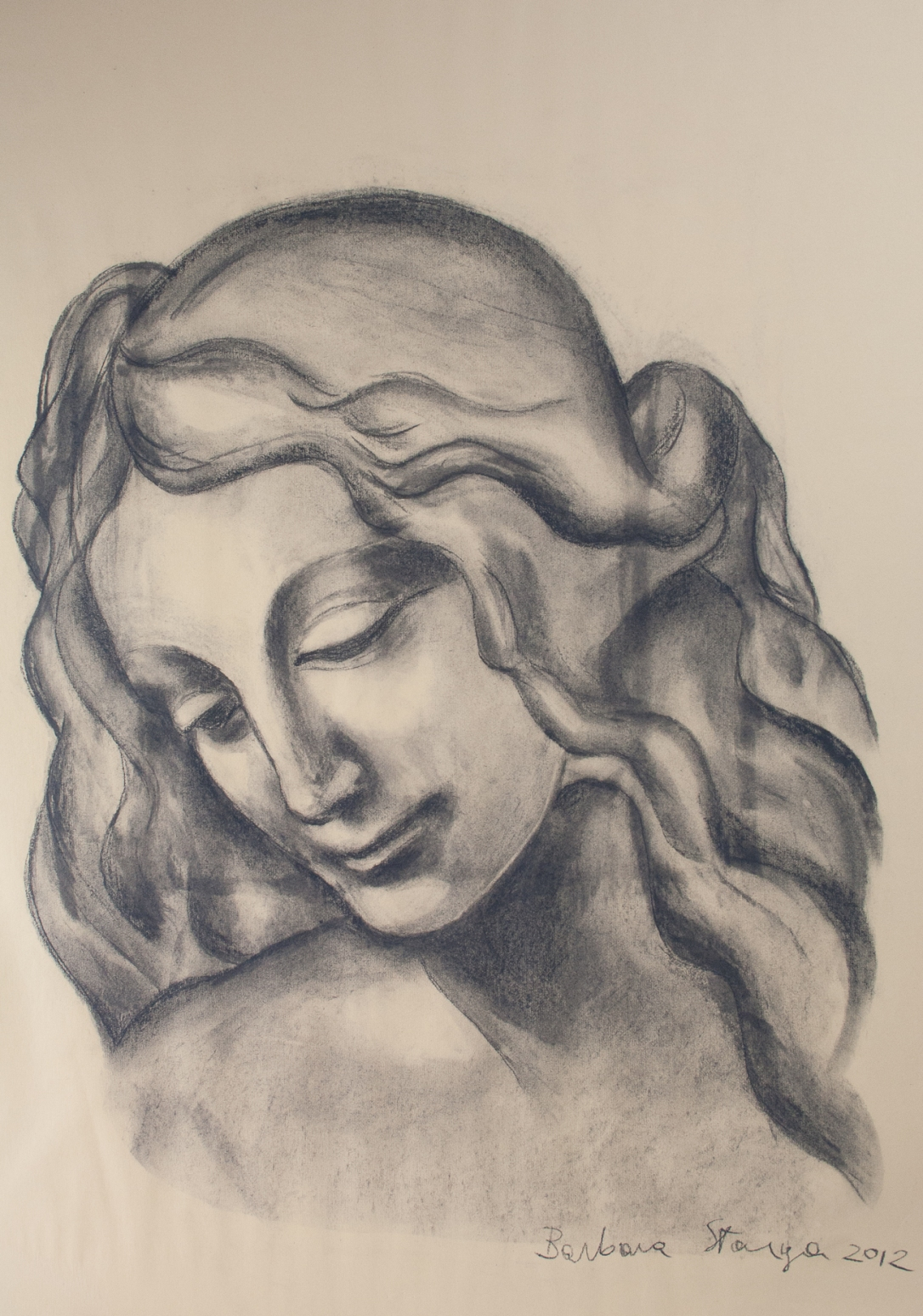 Charcoal drawing on paper representing a young lady with a dreaming expression.