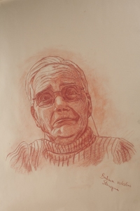Sanguine drawing on paper representing a portrait of an old woman wearing glasses with sad expression