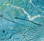 yellow streaks and dots on blue color tones with irregular background. Artwork realized with enamel and tempera colors poured or dripped and smeared on canvas with a knife modified by atmospheric agents with pieces of clotted enamel.