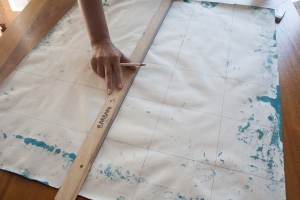 making the grid on the back of light blue abstract painting