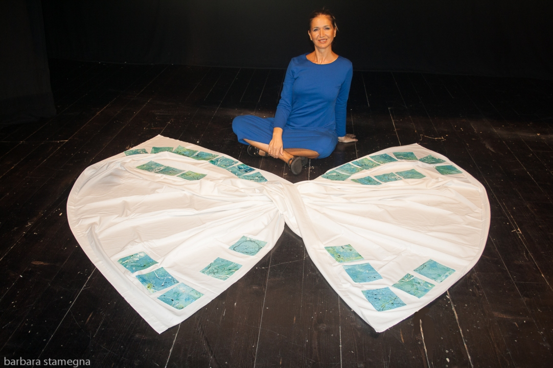 Barbara Stamegna with her art installation sitting on the floor