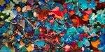 abstract dappled art image with mulltiform colored shapes in dominant red and blue tones
