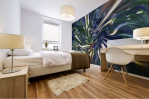 abstract mural print on bedroom wall with fluid pattern and light vortex