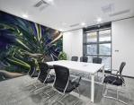 meeting room with blue mural print on the wall with fluid pattern strips of light