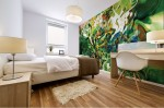 bedroom with abstract green pattern adhesive mural print on the wall, white shades and dots