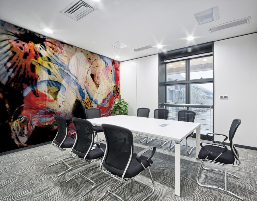 mural decor with abstract pattern in red and white color with shades on meeting room wall