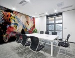 mural decor with abstract dynamic pattern in red, white and black dominant colors on meeting room wall