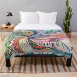 throw blanket with abstract concentric nature creation in tones of pink, blue, green, orange, black and white with curls and shapes of nature