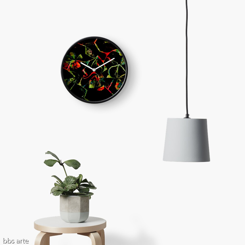 wall clock with abstract floral geometric red and green shapes on black