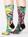 xmas design socks with Christmas colors abstract image in tones of red green, white, black and yellow