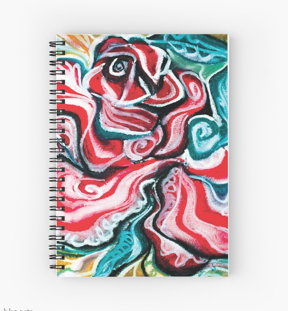 xmas design spiral notebook with Christmas colors abstract image in tones of red green, white, black and yellow