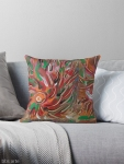 throw pillow with flaming vortex pattern in tones of red, white, green, orange, yellow, brown and black