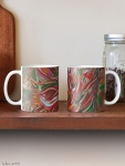 classic mugs with flaming vortex pattern in tones of red, white, green, orange, yellow, brown and black