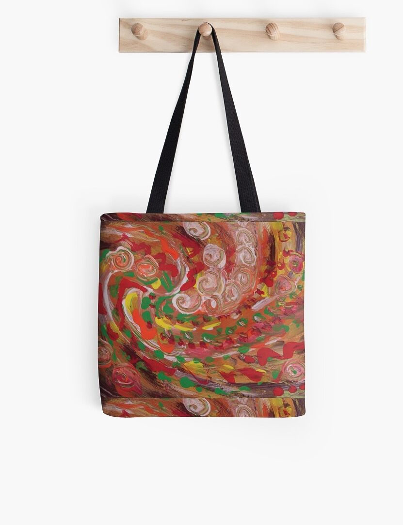 tote bag with swirling curls design, in tones of red, white, green, orange, yellow and brown