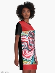 graphic t shirt dress side view with Christmas colors abstract image in tones of red green, white, black and yellow